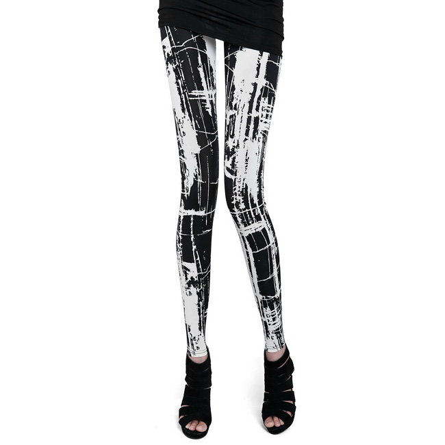 Front view of white & black scribble print leggings